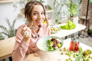 Young woman eating healthy food